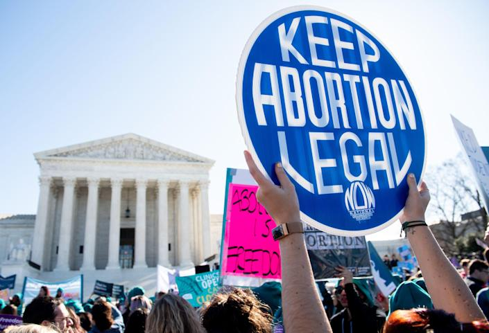 Abortion rights activists protest during a demonstration outside the U.S. Supreme Court on March 4, 2020.