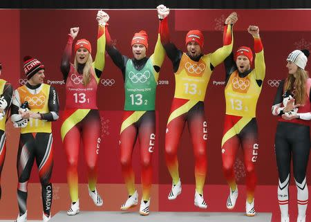 Luge - Pyeongchang 2018 Winter Olympic Games - Team Relay - Pyeongchang, South Korea - February 15, 2018 - Gold medalists Natalie Geisenberger, Johannes Ludwig, Tobias Wendl and Tobias Arlt of Germany celebrate during the victory ceremony. REUTERS/Arnd Wiegmann