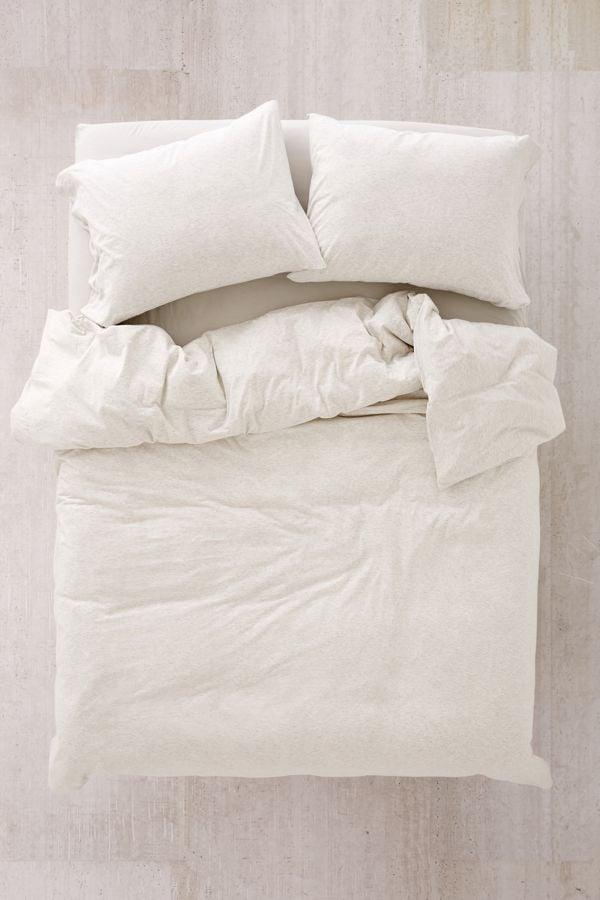 "<p>What's better than sleeping in a soft, comfy t-shirt? Sleeping in an entire bed of soft, comfy t-shirts. This heathered cotton <a href=""https://www.popsugar.com/buy/T-Shirt-Jersey-Duvet-Cover-482437?p_name=T-Shirt%20Jersey%20Duvet%20Cover&retailer=urbanoutfitters.com&pid=482437&price=99&evar1=casa%3Auk&evar9=46521527&evar98=https%3A%2F%2Fwww.popsugar.com%2Fhome%2Fphoto-gallery%2F46521527%2Fimage%2F46521533%2FT-Shirt-Jersey-Duvet-Cover&list1=college%2Cdorms&prop13=api&pdata=1"" rel=""nofollow"" data-shoppable-link=""1"" target=""_blank"" class=""ga-track"" data-ga-category=""Related"" data-ga-label=""http://www.urbanoutfitters.com/shop/heathered-jersey-duvet-cover?color=006"" data-ga-action=""In-Line Links"">T-Shirt Jersey Duvet Cover</a> ($99-$149) will feel like a big hug but may make it harder to get out of bed for those morning classes.</p>"