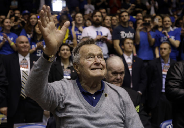 <p>Former President George H.W. Bush is introduced during the first half of an NCAA college basketball game between Duke and North Carolina State in Durham, N.C., on Jan. 18, 2014. (Photo: Gerry Broome/AP) </p>
