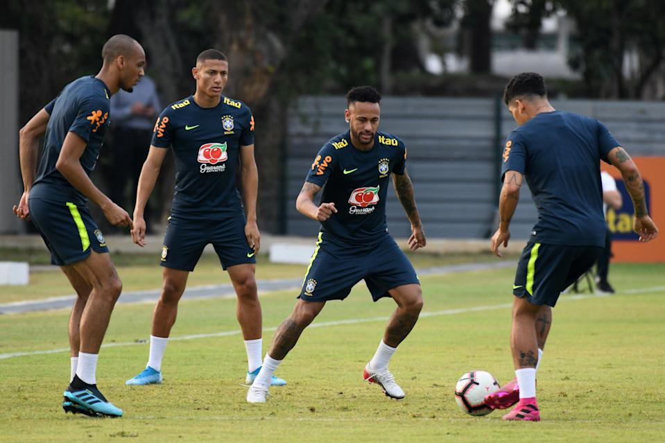Brazil's Neymar (2nd R) attends a training session with teammates in Singapore on October 7, 2019, ahead of their friendly international football matches against Senegal and Nigeria. - Brazil's Neymar (C) and teammates attend a training session in Singapore on October 7, 2019, ahead of their friendly international football matches against Senegal and Nigeria. (Photo by ROSLAN RAHMAN / AFP) (Photo by ROSLAN RAHMAN/AFP via Getty Images)