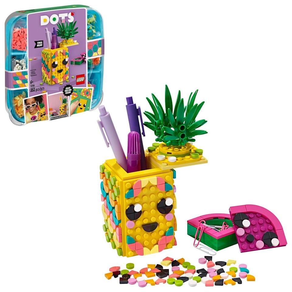 "<p>The <a href=""https://www.popsugar.com/buy/Lego-Dots-Pencil-Holder-Kit-572084?p_name=Lego%20Dots%20Pencil%20Holder%20Kit&retailer=michaels.com&pid=572084&price=20&evar1=moms%3Aus&evar9=47243673&evar98=https%3A%2F%2Fwww.popsugar.com%2Ffamily%2Fphoto-gallery%2F47243673%2Fimage%2F47243712%2FLego-Dots-Pencil-Holder-Kit&list1=toys%2Ctoy%20fair%2Ckid%20shopping%2Ckids%20toys&prop13=api&pdata=1"" class=""link rapid-noclick-resp"" rel=""nofollow noopener"" target=""_blank"" data-ylk=""slk:Lego Dots Pencil Holder Kit"">Lego Dots Pencil Holder Kit</a> ($20) has 351 pieces and is intended for kids ages 6 and up.</p>"