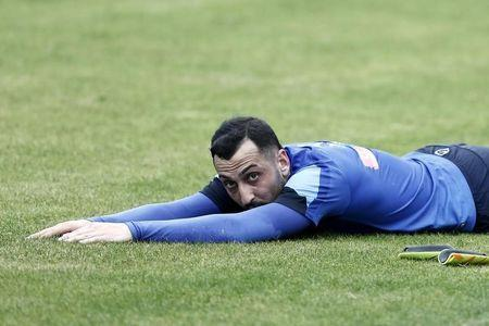 Greece's Kostas Mitroglou stretches during a training session in Athens