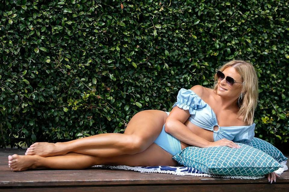 Sonia Kruger took some time to relax poolside in a 'glamorous' blue bikini. Photo: Instagram/soniakruger.