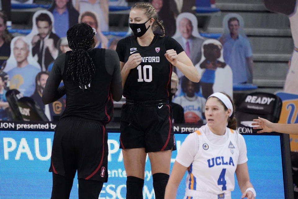 Stanford forward Francesca Belibi, left, and Cameron Brink (22) celebrate after a win over UCLA during an NCAA college basketball game Monday, Dec. 21, 2020, in Los Angeles. (AP Photo/Marcio Jose Sanchez)