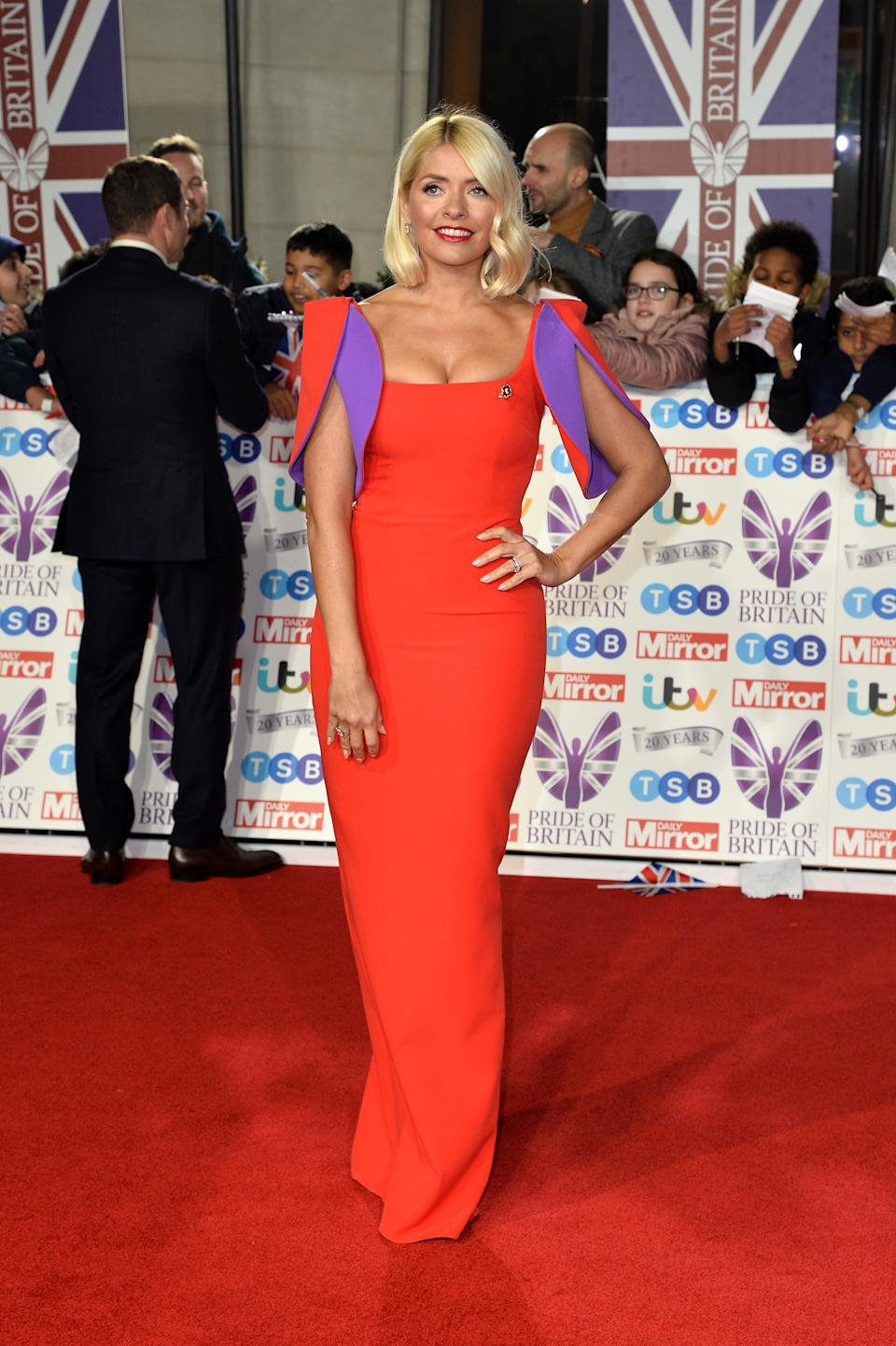 """Holly wore a statement red dress with purple accents by Safiyaa. The dress is <a href=""""https://fave.co/2BT8Nxa"""" rel=""""nofollow noopener"""" target=""""_blank"""" data-ylk=""""slk:available to buy for £1,095"""" class=""""link rapid-noclick-resp""""><strong>available to buy for £1,095</strong></a>. <em>[Photo: Getty]</em>"""