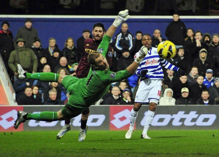 QPR's Loic Remy (R) watches his shot go wide of Manchester City's Joe Hart (L) in London on January 29, 2013