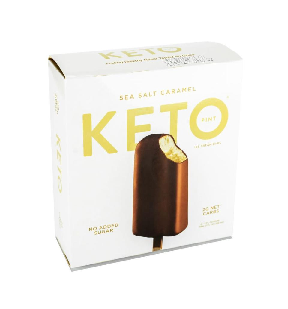 """<p><strong>Keto Pint</strong></p><p>ketopint.com</p><p><a href=""""https://ketopint.com/collections/keto-bars/products/sea-salt-caramel-keto-ice-cream-bars"""" rel=""""nofollow noopener"""" target=""""_blank"""" data-ylk=""""slk:BUY NOW"""" class=""""link rapid-noclick-resp"""">BUY NOW</a></p><p>""""These are one-of-a-kind and the only keto ice cream bars on the market, for now. They come in three delicious flavors and have just 2 grams net carbs per serving,"""" says Martin. Each bar features a dark chocolate coating with a creamy ice cream center. The Sea Salt Caramel has 160 calories, 2 g net carbs, and 1 g sugar per bar.</p>"""