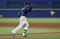 Tampa Bay Rays' Wander Franco reacts as he runs around the bases after his three-run home run off Boston Red Sox starting pitcher Eduardo Rodriguez during the fifth inning of a baseball game Tuesday, June 22, 2021, in St. Petersburg, Fla. (AP Photo/Chris O'Meara)