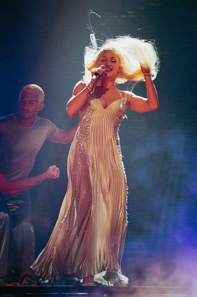 <p>Performing her single 'Bedtime Story' at the 1995 show, a blonde Madonna for which she reportedly wore a white Versace plisse dress with diamond panels.</p>