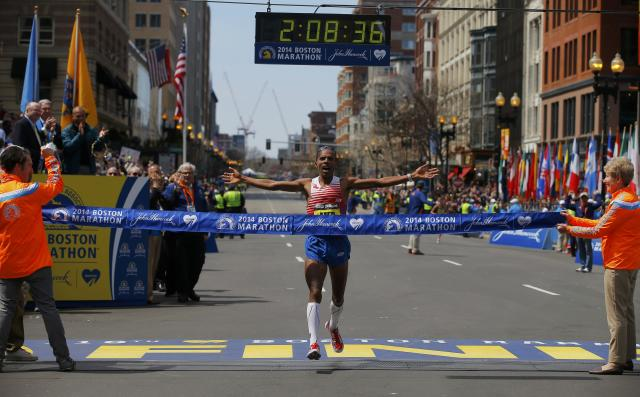 Meb Keflezighi of the U.S. reacts as he comes to the finish line at the 118th running of the Boston Marathon