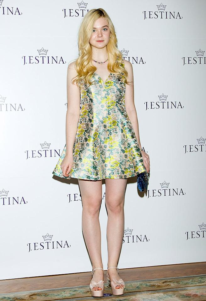Elle Fanning has the perfect milky complexion for flowery frocks, and the 14-year-old looked absolutely adorable (and ready for Easter festivities!) in an Opening Ceremony cocktail dress at the J.Estina SS 2013 campaign presentation in Seoul, South Korea. (1/7/2013)
