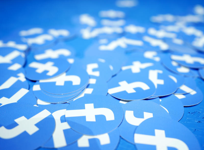 FILE - In this April 30, 2019, file photo, Facebook stickers are laid out on a table at F8, Facebook's developer conference in San Jose, Calif. The Boston-based renewable energy developer Longroad Energy announced in May that Facebook is building a massive new solar farm in West Texas, a project believed to be one of the largest in the nation and the social media giant's first direct investment in renewable energy. (AP Photo/Tony Avelar, File)