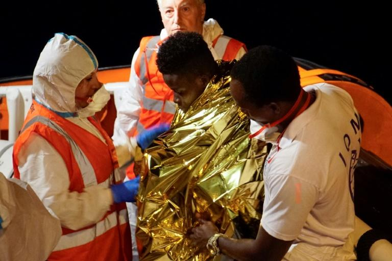 Some migrants were taken off for medical treatment; others tried to swim ashore from the boat (AFP Photo/Handout)