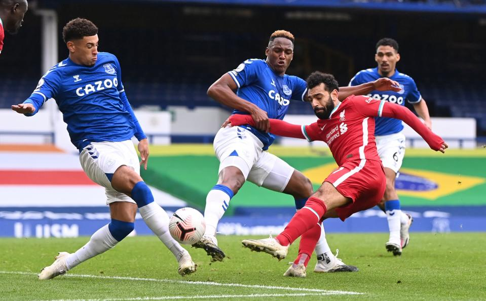 Liverpool's Mohamed Salah (red jersey) in action with Everton's Ben Godfrey and Yerry Mina.