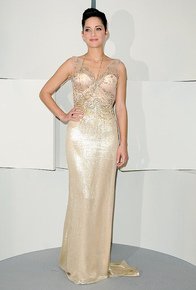 """Elegant as always, Marion Cotillard shone in a golden Christian Dior Spring 2010 gown at the 35th Cesar Film Awards in Paris. Francois Durand/<a href=""""http://www.gettyimages.com/"""" target=""""new"""">GettyImages.com</a> - February 27, 2010"""