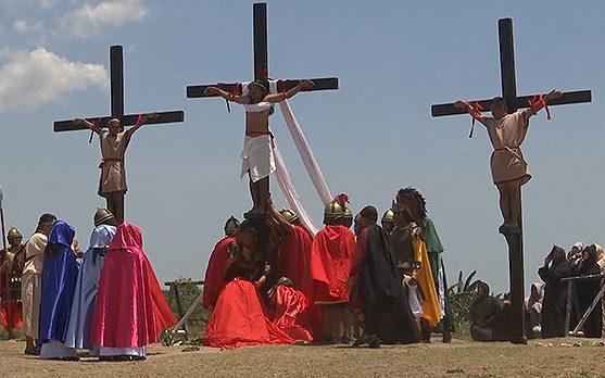 Three penitents are nailed to crosses during the Easter Friday ceremony - Credit: APTN