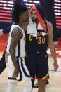 Memphis Grizzlies' Ja Morant, left, speaks with Golden State Warriors' Stephen Curry after an NBA basketball Western Conference play-in game in San Francisco, Friday, May 21, 2021. (AP Photo/Jed Jacobsohn)