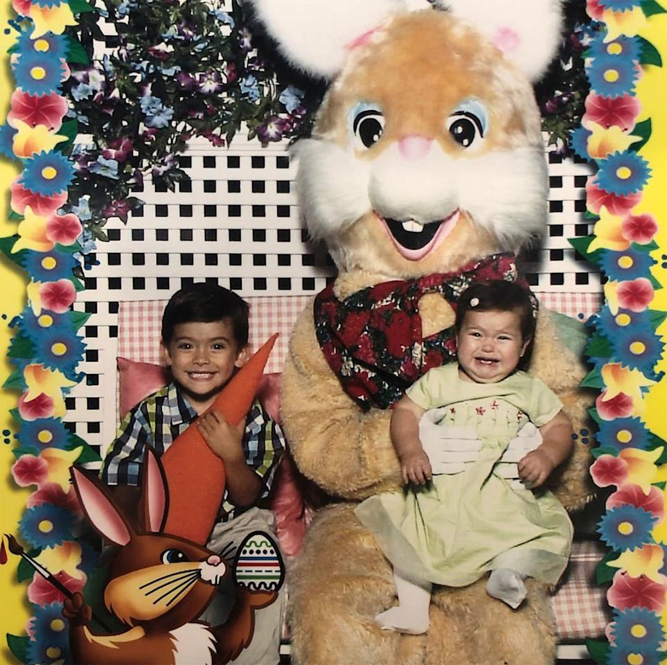Older brother Michael didn't seem to have a problem posing with a rather large Easter Bunny back in 2002, but baby Lola was clearly terrified.