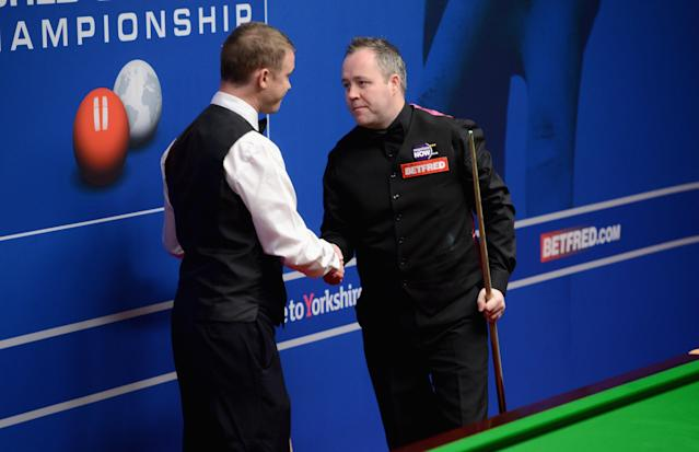 SHEFFIELD, ENGLAND - APRIL 28: John Higgins shakes hand with Stephen Hendry after he concedes his second round match during The Betfred.com World Snooker Championship at Crucible Theatre on April 28, 2012 in Sheffield, England. (Photo by Gareth Copley/Getty Images)