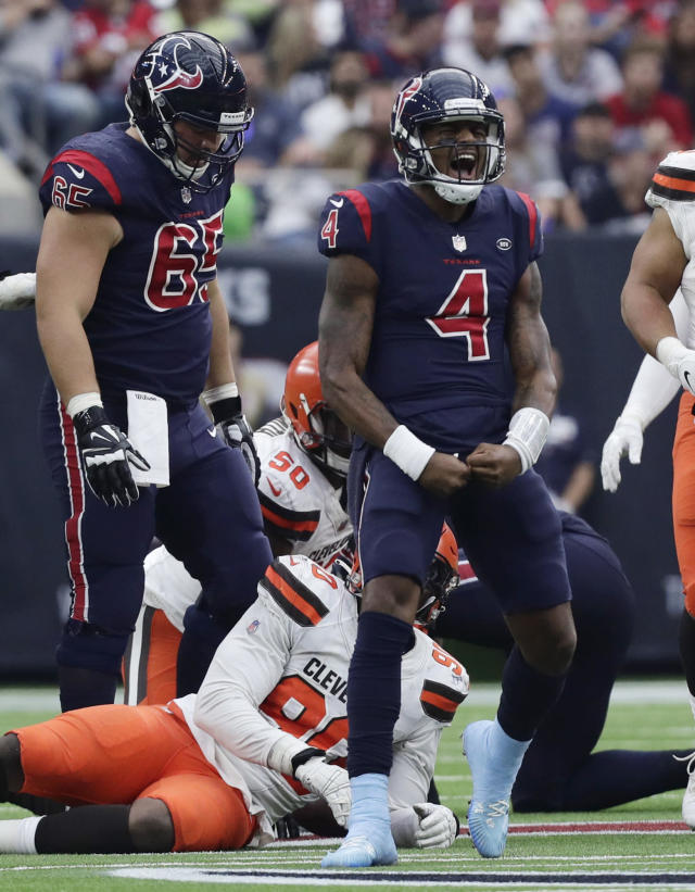 Houston Texans quarterback Deshaun Watson (4) celebrates after rushing for a first down against the Cleveland Browns during the second half of an NFL football game, Sunday, Dec. 2, 2018, in Houston. (AP Photo/Sam Craft)