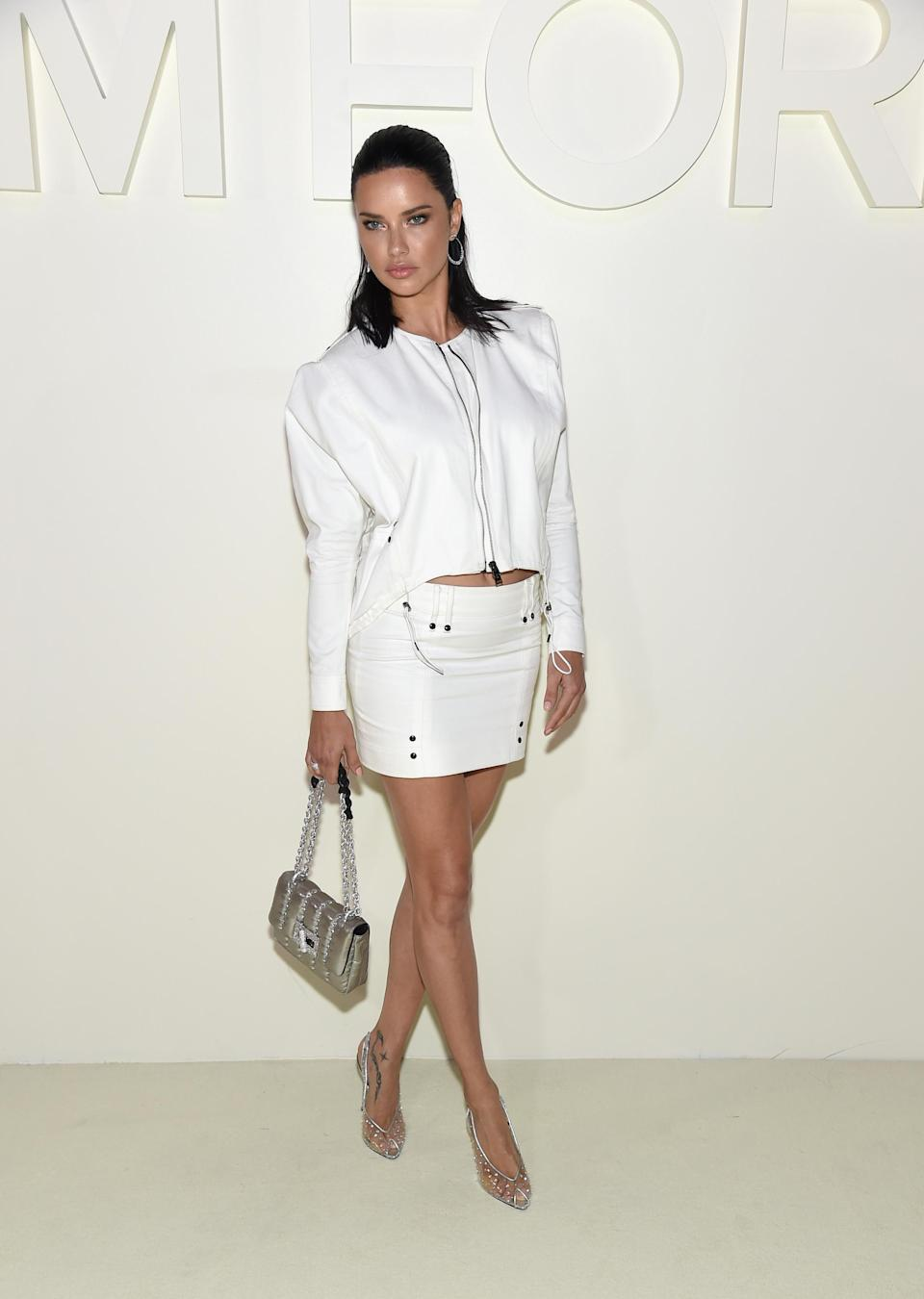 <p>On September 5, model Adriana Lima chose a white leather co-ord to sit FROW at the Tom Ford show. <em>[Photo: Getty]</em> </p>