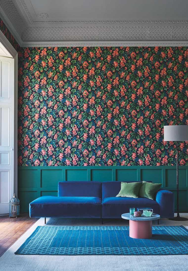 """<p>Love jewel colours? Bring colour and character to your living room with punchy hues. Team <a href=""""https://www.housebeautiful.com/uk/renovate/diy/a35288060/how-to-panel-wall/"""" rel=""""nofollow noopener"""" target=""""_blank"""" data-ylk=""""slk:wall panelling"""" class=""""link rapid-noclick-resp"""">wall panelling</a> with a pretty, floral wallpaper design to make your room sing with personality. </p><p>Pictured: Bougainvillea (Rouge, Leaf Green & Cerulean Sky on Charcoal), <a href=""""https://go.redirectingat.com?id=127X1599956&url=https%3A%2F%2Fwww.wallpaperdirect.com%2Fproducts%2Fcole-son%2Fbougainvillea%2F167257&sref=https%3A%2F%2Fwww.housebeautiful.com%2Fuk%2Fdecorate%2Fliving-room%2Fg35838996%2Fliving-room-wallpaper-ideas%2F"""" rel=""""nofollow noopener"""" target=""""_blank"""" data-ylk=""""slk:Cole & Son"""" class=""""link rapid-noclick-resp"""">Cole & Son</a></p>"""