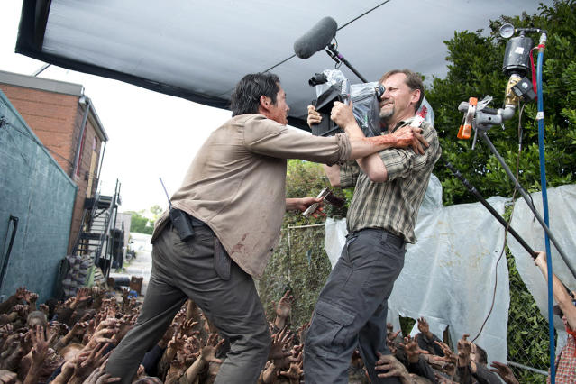 <p>Steven Yeun gets right up in the camera while filming the big Dumpster scene, i.e. the death he survived.<br><br>(Photo Credit: Gene Page/AMC) </p>