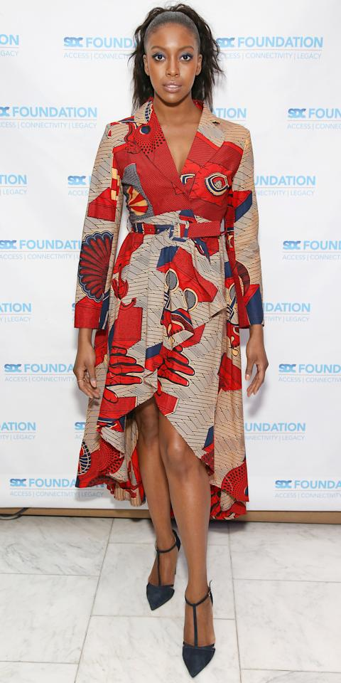 <p>Condola Rashad stunned in a trench coat-inspired dress while at the SDC Foundation Benefit. The actress accentuated the blue in the high-low dress by pairing it with matching T-strap pumps.</p>