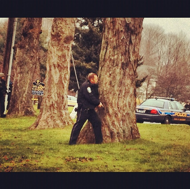 Police and SWAT team members approach a Newtown church with weapons drawn after unspecifi @ St. Rose of Lima. (Dylan Stableford/Yahoo! News)