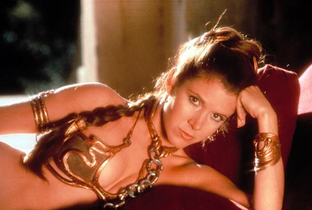 Carrie Fisher wears Leia's iconic — and controversial — golden bikini in <em>Return of the Jedi.</em> (Photo: Courtesy of Everett Collection)