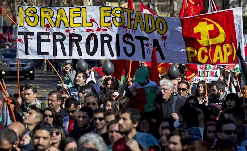 People take part in a demonstration outside the Israeli Embassy in Santiago, Chile, on July 19, 2014, to protest against Israel's military campaign in Gaza and show their support to the Palestinian people