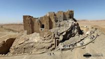 The site of the Fakhr-al-Din al-Ma'ani Castle, known as the Palmyra citadel, on a hilltop in the ancient city of Palmyra on April 1, 2016, after it was partially destroyed by Islamic State Jihadists