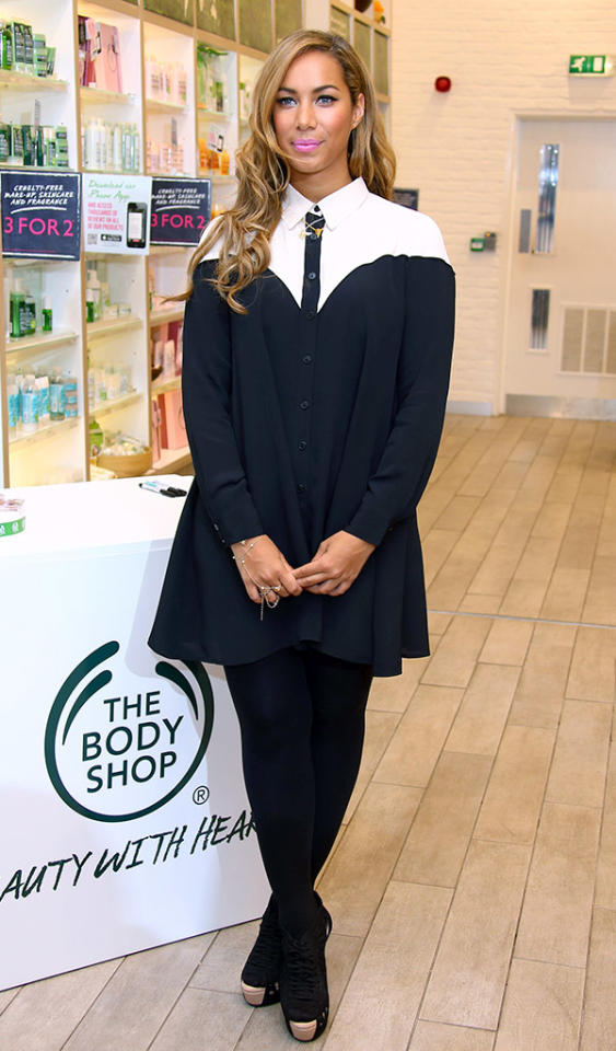 "Conservative ensembles can be cute, right? We think so, and we also happen to think Leona Lewis looked adorable in this ASOS shirt dress at a Body Shop event in London, where she was named celebrity ambassador for the cosmetics company. The ""Bleeding Love"" singer's accessories included dark wedges, matching tights, and layered necklaces. (3/27/2013)"