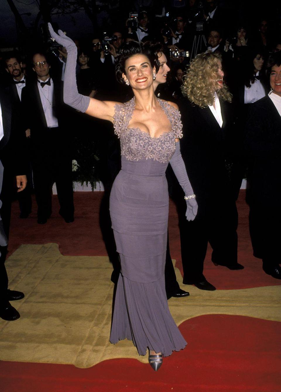 <p>Demi Moore arrives in a purple-grey floral number. </p>