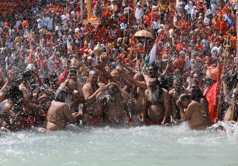 "FILE PHOTO: Sadhus take a dip in the Ganges river during ""Kumbh Mela"", or the Pitcher Festival, in Haridwar"