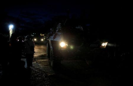 Armoured Personnel Carrier (APC) drives along a main street to reinforce government soldiers on their continuous assault with insurgents from the so-called Maute group, who has taken over large parts of the city, in Marawi, Philippines May 26, 2017. REUTERS/Romeo Ranoco