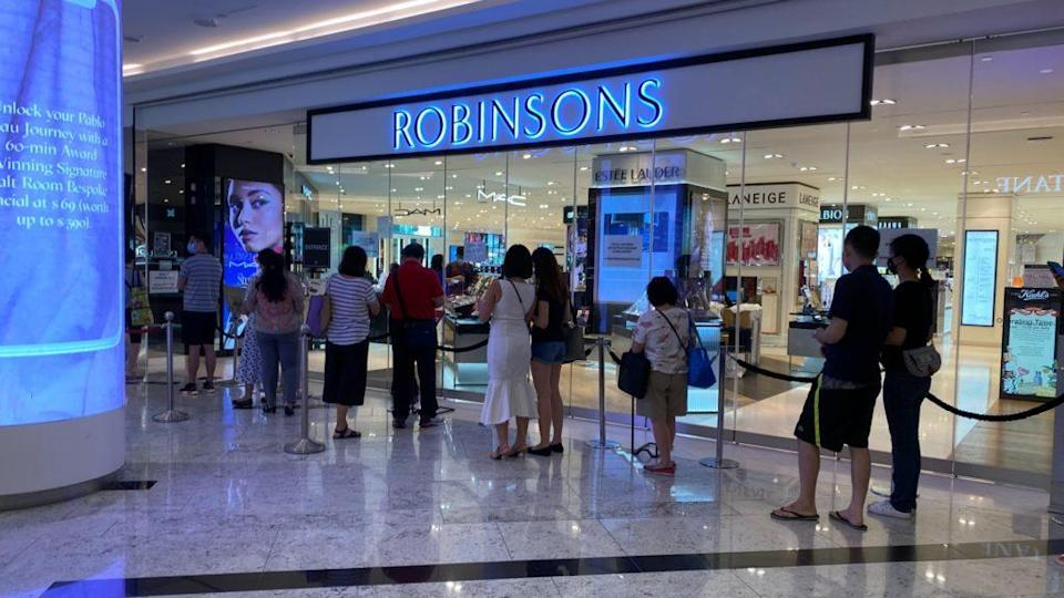 The line that continued past neighboring stores and back at the Raffles City outlet this morning. Photo: Coconuts