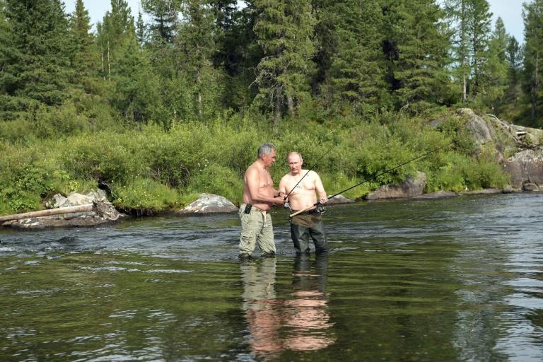 Shoigu, shown here fishing with Putin in 2017, has led a drive to modernise and acquire new weaponry for Russia's military
