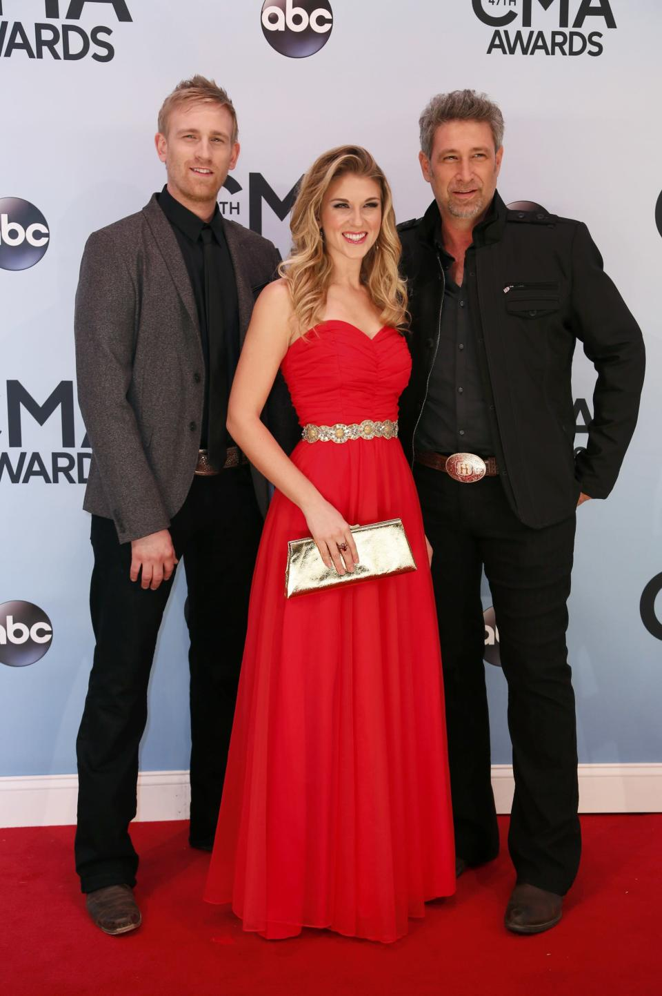 Singing trio The Henningsens, Brian Henningsen (R), his son Aaron, and daughter Clara, arrive at the 47th Country Music Association Awards in Nashville, Tennessee November 6, 2013. REUTERS/Eric Henderson (UNITED STATES - Tags: ENTERTAINMENT)