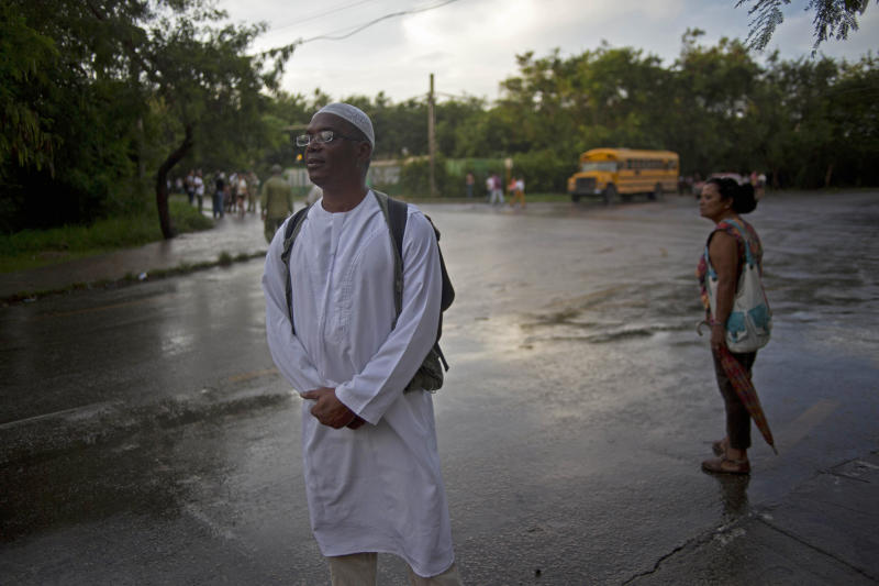U.S. citizen William Potts waits for a taxi to drive him to the U.S. Interest Section in Havana, Cuba, Wednesday, Nov. 6, 2013. On Wednesday, nearly three decades after he forced an airliner to bring him to the Communist-run island, he was heading back to the U.S. and an uncertain legal future. FBI agents took the 56-year-old Potts into custody Wednesday shortly after his charter flight from Havana arrived at Miami International Airport. (AP Photo/Ramon Espinosa)