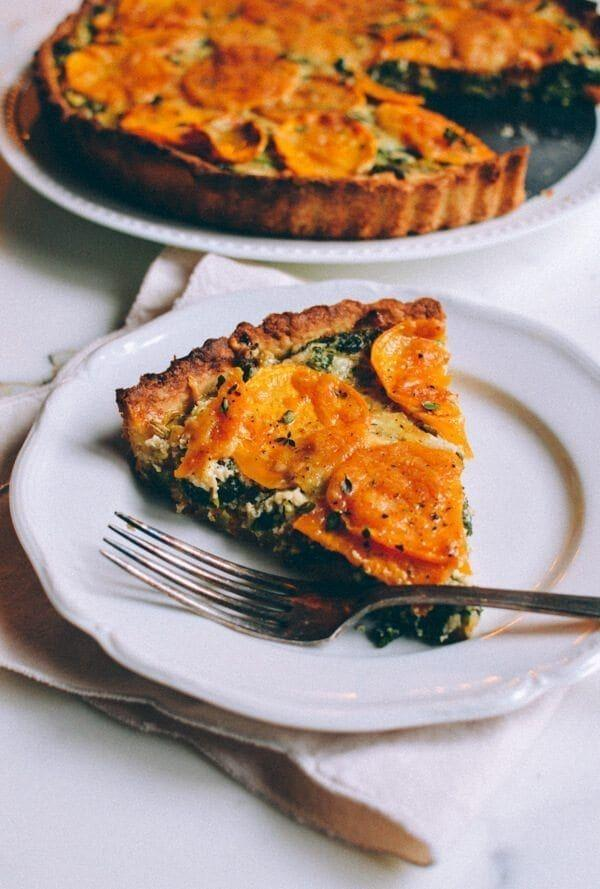 """<p>This tart would be a perfect Thanksgiving side dish or even just a delicious fall lunch. A cheesy kale and leek filling is layered with thin sweet potato slices.</p><p><strong>Get the recipe at <a href=""""https://thewoksoflife.com/cheesy-kale-sweet-potato-tart/"""" rel=""""nofollow noopener"""" target=""""_blank"""" data-ylk=""""slk:The Woks of Life"""" class=""""link rapid-noclick-resp"""">The Woks of Life</a>.</strong></p><p><a class=""""link rapid-noclick-resp"""" href=""""https://go.redirectingat.com?id=74968X1596630&url=https%3A%2F%2Fwww.walmart.com%2Fsearch%2F%3Fquery%3Dtart%2Bpans&sref=https%3A%2F%2Fwww.thepioneerwoman.com%2Ffood-cooking%2Fmeals-menus%2Fg36876289%2Fsweet-potato-side-dishes%2F"""" rel=""""nofollow noopener"""" target=""""_blank"""" data-ylk=""""slk:SHOP TART PANS"""">SHOP TART PANS</a></p>"""