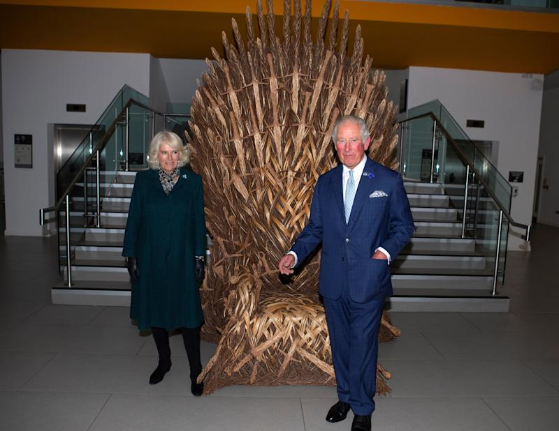 Britain's Prince Charles, Prince of Wales and his wife Britain's Camilla, Duchess of Cornwall look at a throne made for a party to celebrate the end of filming of the TV series 'Game of Thrones', during their visit to the Ulster Museum in Belfast on September 30, 2020. (Photo by Ian Vogler / POOL / AFP) (Photo by IAN VOGLER/POOL/AFP via Getty Images)