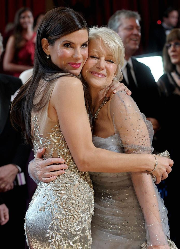 Actresses Sandra Bullock and Helen Mirren arrive at the 82nd Annual Academy Awards held at the Kodak Theatre on March 7, 2010 in Hollywood, California.
