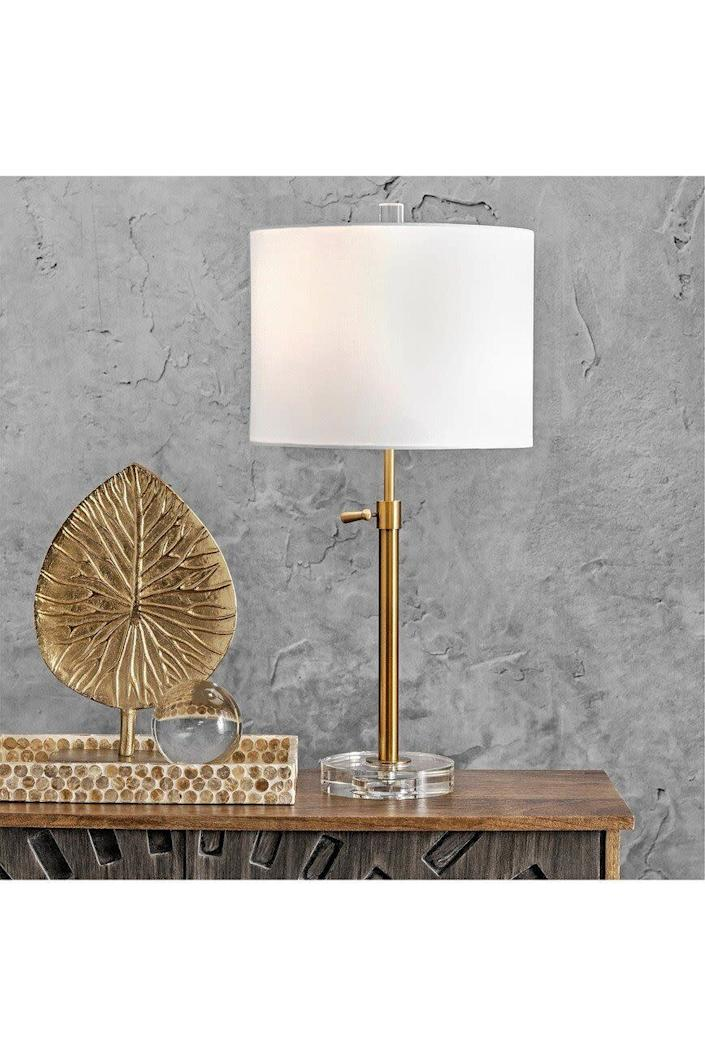"""This glamorous lamp has a crystal clear base that makes it look much more pricey. It has an on/off switch near the shade. The lamp requires a <a href=""""https://fave.co/3hyE7DN"""" rel=""""nofollow noopener"""" target=""""_blank"""" data-ylk=""""slk:100-watt LED bulb"""" class=""""link rapid-noclick-resp"""">100-watt LED bulb</a> as well. <a href=""""https://fave.co/2FvbN8c"""" rel=""""nofollow noopener"""" target=""""_blank"""" data-ylk=""""slk:Find it for $60 at Nordstrom Rack"""" class=""""link rapid-noclick-resp"""">Find it for $60 at Nordstrom Rack</a>."""