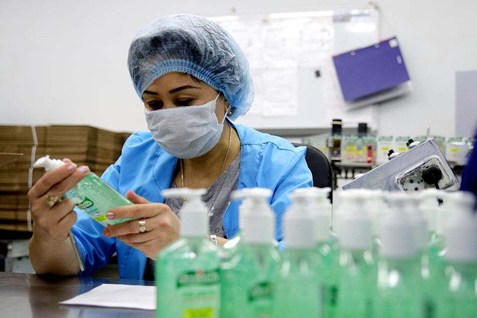 MOSCOW, RUSSIA - MARCH 23, 2020: An employee ahead of packaging bottles of Sanitelle hand sanitizer at a Bentus Laboratories plant. Sergei Bobylev/TASS (Photo by Sergei Bobylev\TASS via Getty Images)