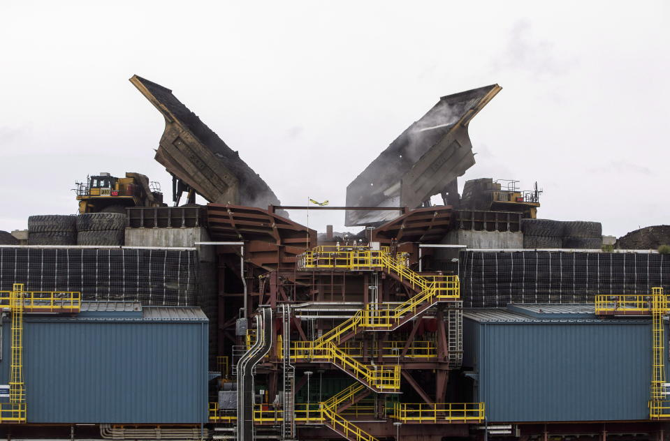 Heavy haul trucks dump material into a crusher at the Suncor Fort Hills facility in Fort McMurray Alta, on Monday September 10, 2018.THE CANADIAN PRESS/Jason Franson