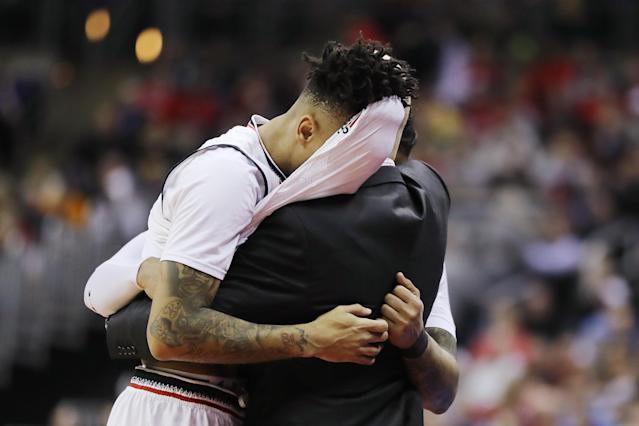 <p>Justin Jenifer #3 and Cane Broome #15 of the Cincinnati Bearcats hug head coach Mick Cronin after being defeated by the Iowa Hawkeyes 79-72 in the first round of the 2019 NCAA Men's Basketball Tournament at Nationwide Arena on March 22, 2019 in Columbus, Ohio. </p>