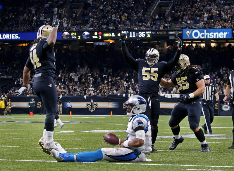Saints linebacker Jonathan Freeny (55) celebrates his sack of Carolina's Cam Newton. New Orleans got to him four times in Sunday's tight NFC wild-card game. (AP)