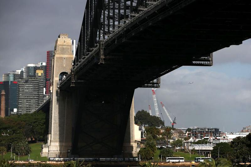 Sydney Harbor Bridge stands next to commercial and residential buildings in the central business district in Sydney, Australia. Source: Getty
